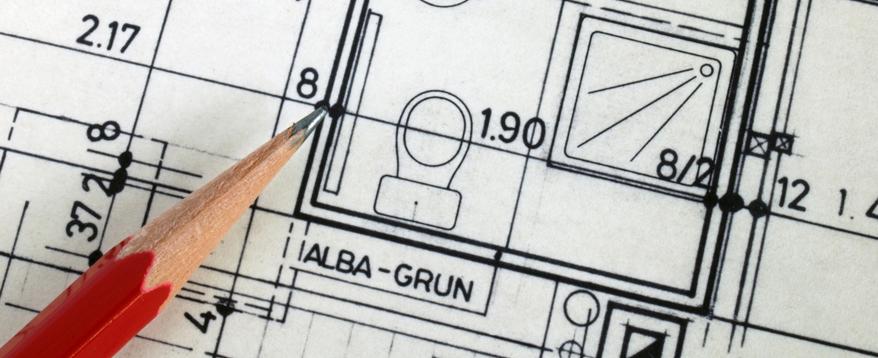 Genaues Vermessen und ein exakter Plan mit Stift und Papier helfen die Kosten der Bad-Renovierung zu senken